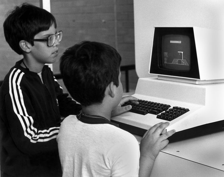 Two young boys playing a game of hangman on a Commodore PET.