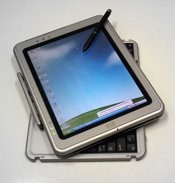 Photo of HP Tablet PC running Windows XP Tablet PC Edition. The tablet is partially rotated to reveal the corners of its keyboard.
