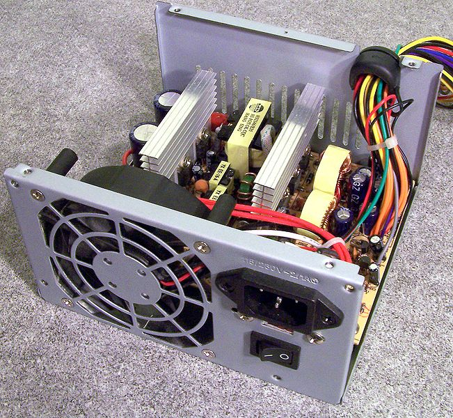 This is a Power Supply Unit, or PSU, for an ATA computer. The top cover has been removed to show the internals. As can be seen from the stamped input rating (2A at 115V or 1A at 230V is 230 W), this is a low-power supply. Assuming 75% efficiency, that's about 160W maximum output.
