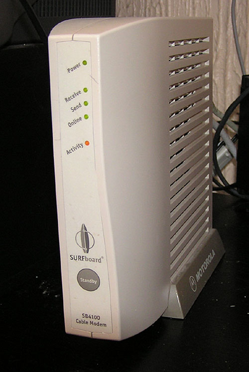 Cable modem Motorola SurfBoard for broadband internet. It is a small independently standing box.