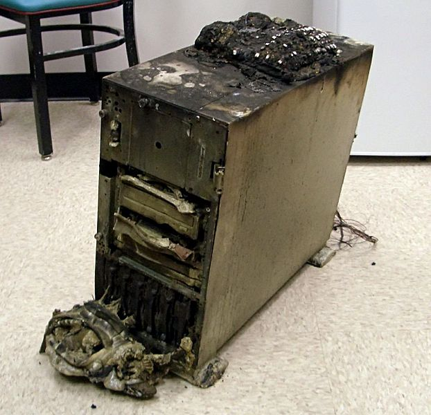 A computer server that was destroyed in the Choteau fire in NE Oklahoma. There's a completely melted and nearly unrecognizable telephone on top.