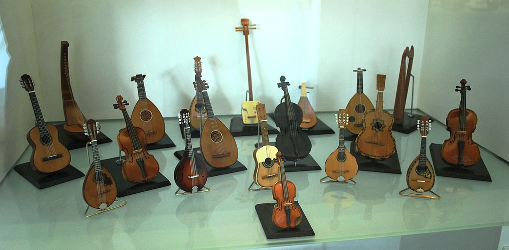 A display of folk string instruments such as guitars and violins