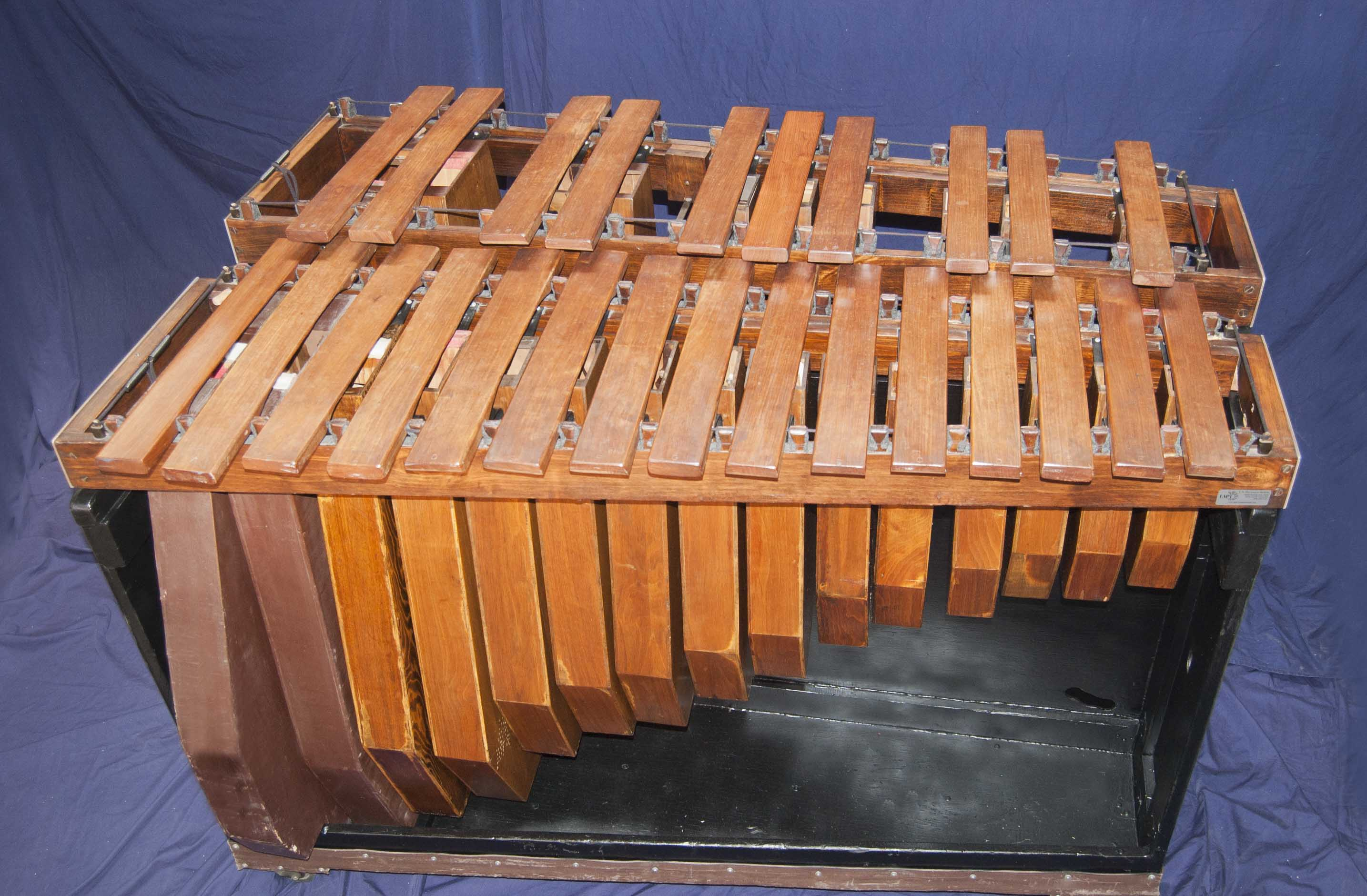 Contra Bass Marimba made of wood with two levels, one for whole tones and one for half tones.