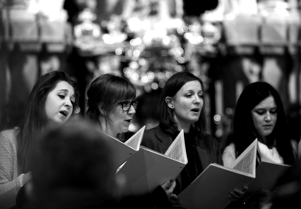 Black-and-white photo of women singing in a choir.