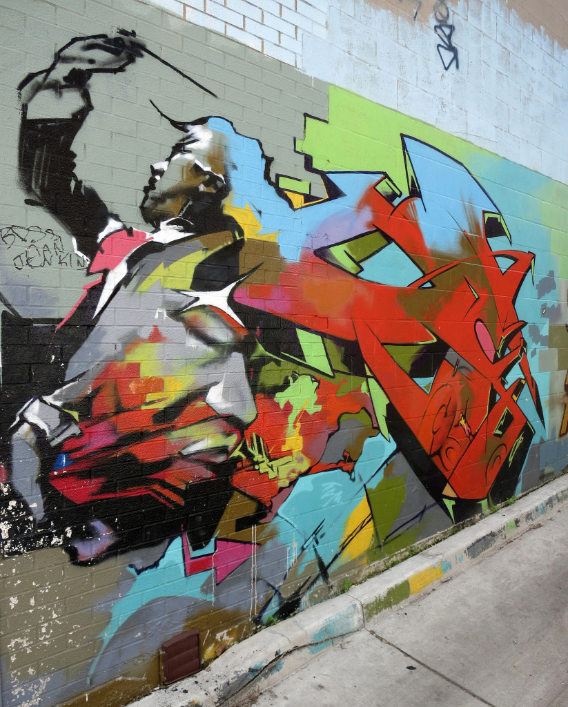 Abstract mural of a conductor painted on a city building