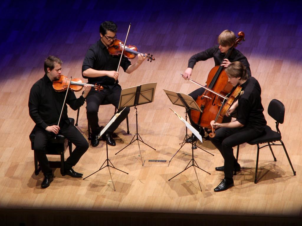 Photo of the Orava Quartet onstage.