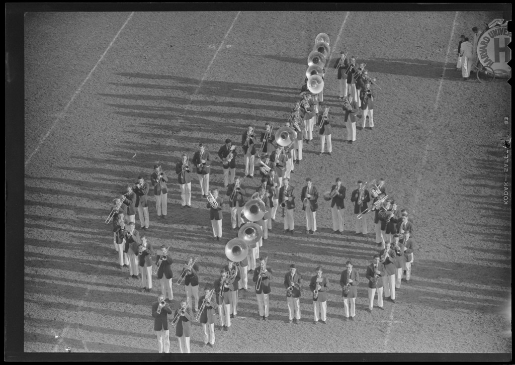 Photo of Harvard band forming music notes on field, Harvard vs. Brown, 1949