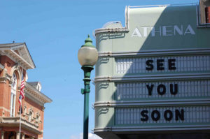 "Movie marquee for the Athena theater. Message reads ""see you soon."""