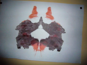 Rorschach image with black and red smudges