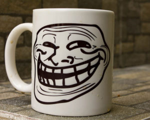 Coffee mug with a stretched-out smiling face on it