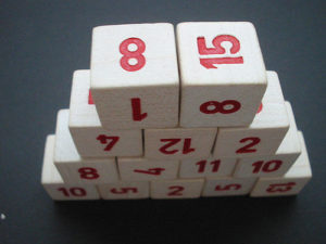 Stack of dice with numbers rather than dots on each side