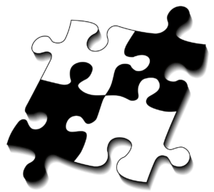 Four puzzle pieces fitting together.