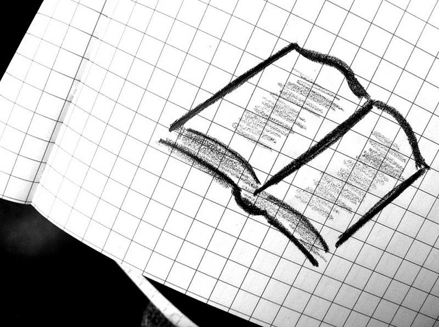 corner of graphing paper showing a doodle of an open book
