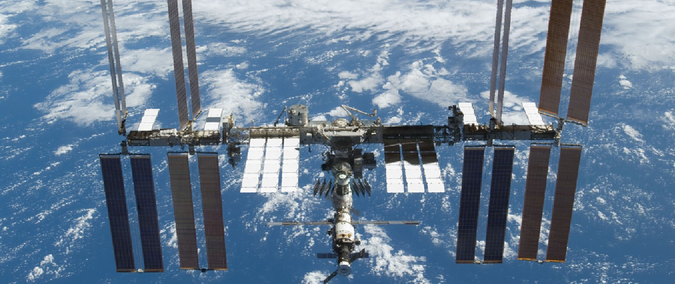 Photograph of the International Space Station in orbit around the Earth.