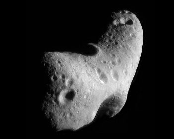 Image of the Asteroid Eros. Like nearly all asteroids, Eros is not spherical but very irregular in shape, in this case similar to a potato. The surface is pock-marked with many craters.