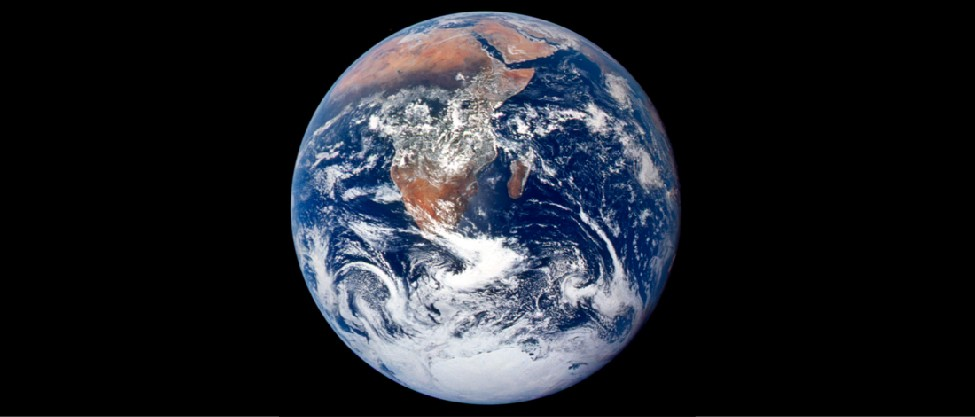 Image of Earth from Space. This photograph shows Africa, the Arabian Peninsula, Madagascar, and Antarctica surrounded by the Atlantic & Indian oceans. Numerous cloud formations are scattered across the globe.
