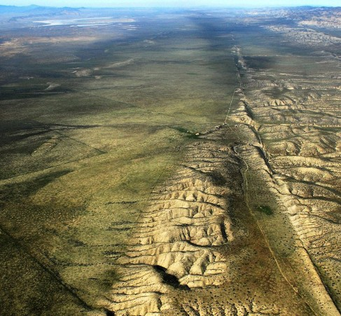 Image of the San Andreas Fault in California. In this aerial photo we see the relatively straight trench-like fault line running off to the horizon.