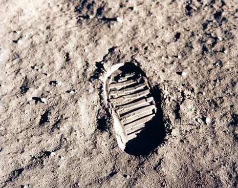 Footprint on the Moon. Photograph of a single boot print in the grey Lunar soil.
