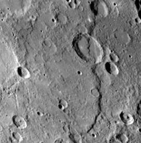 Large Scarp on Mercury. This long cliff structure crosses both flat lands and craters as it extends down the right hand side of this image.