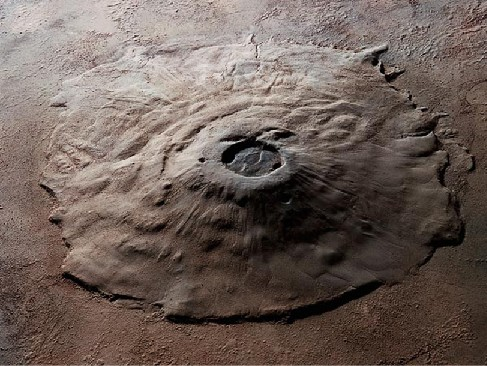 Computer-generated image of Olympus Mons. This huge, dome-shaped volcano rises out of the surrounding plain. At the top and very near the center of the dome is the large caldera.