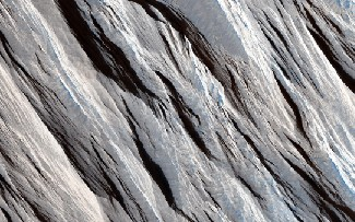 Maritan wind erosion. The long, straight wind-blown ridges cross this image from the upper left to the lower right.
