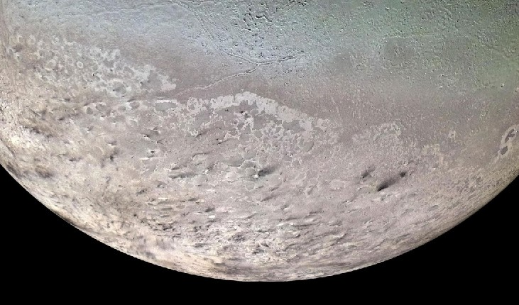 An image of Neptune's Moon Triton. At the bottom of the image is the southern polar cap.