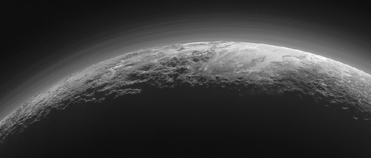 An image of a portion of the surface of Pluto edge-on, showing twelve layers of haze over the planet's surface.