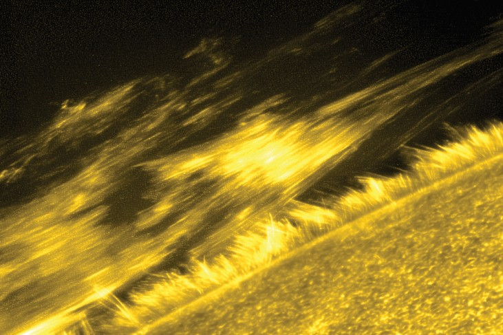An image of a portion of the transition region of the corona, showing a filament, or ribbon-like structure made up of many individual threads.