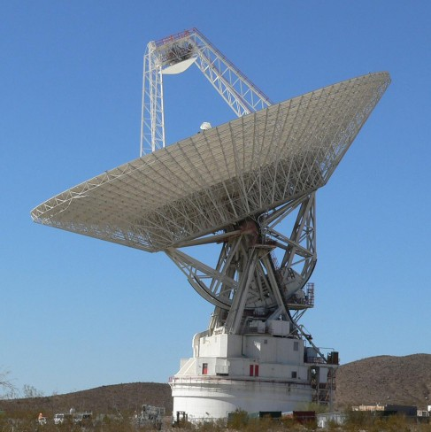 This is a photograph of one of NASA's Deep Space Network radio telescopes, seen in profile and pointing skyward.