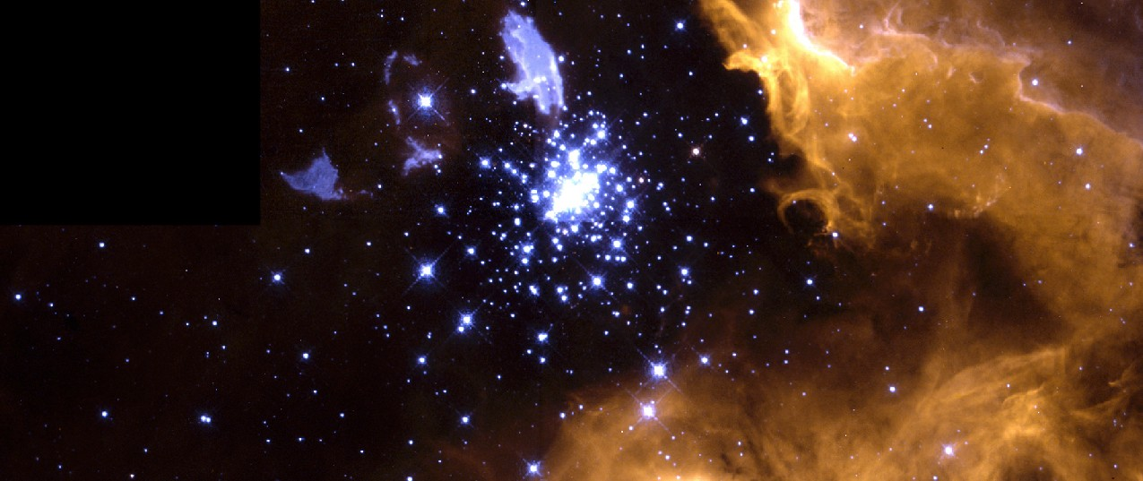 Image of NGC 3603 and Its Parent Cloud. The bright blue stars of the compact star cluster seen just above center in this image have blown a bubble in the gas cloud from which they formed. Part of this reddish cloud is seen in the right hand side and lower center of the frame. Irregular blue clouds and streaks are seen above and to the left of the star cluster.