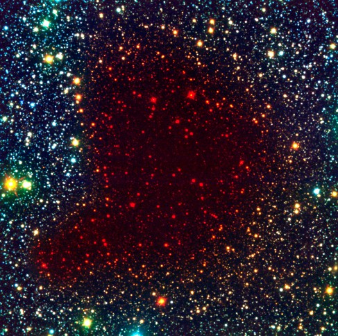 Barnard 68 in Infrared Light. The same comma-shaped region is shown here as in Figure 20_03_Cloud, but in this case stars are seen all across the nebula since long wavelength infrared light can penetrate the gas and dust of the nebula.