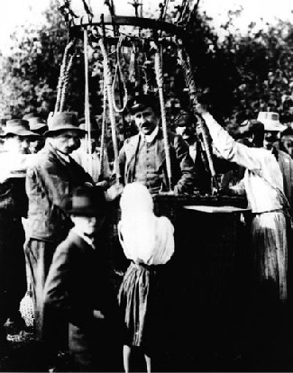 Photograph of Victor Hess standing in the gondola of his research balloon.
