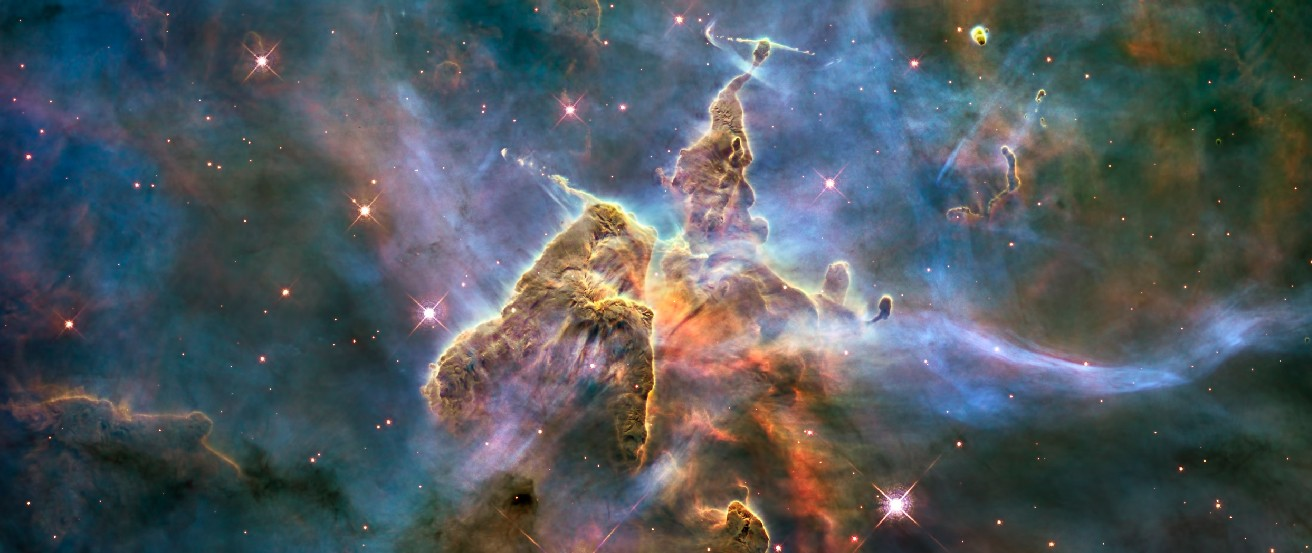 The Carina Nebula. This image shows two cone-shaped nebulae within the larger Carina Nebula. At the very top, or apex, of each gaseous