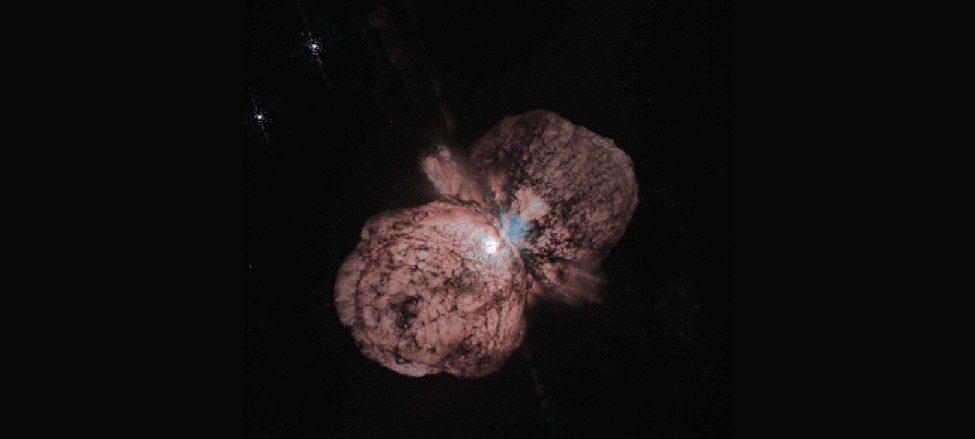The Eta Carinae Ejection Nebula. At the center of this H S T image is the slightly obscured star Eta Carinae which is surrounded by two giant lobes and an equatorial disk of material.