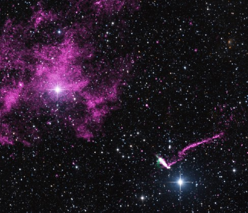 Multi-wavelength Image of a Pulsar's Trail. The thin trail of light left as the pulsar moves through space is seen at lower right, above one of two bright stars in this image. The other bright star is at upper left, surrounded by a cloud of diffuse gas.