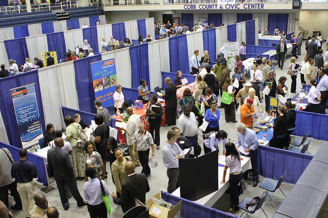 Photo looking down on a crowded convention hall during a job fair