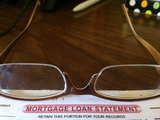 Pair of glasses resting on a Mortgage Loan Statement