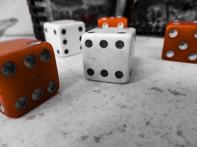 Five dice, red and white, on a marble surface