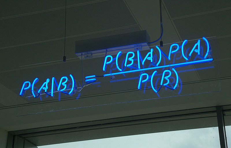 Blue neon sign of Bayes' Theorem equation