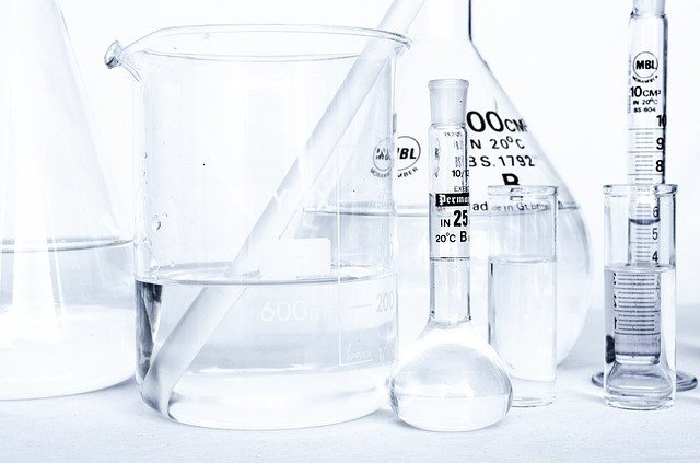Collection of clear glass scientific measuring equipment, with clear liquid in them