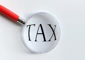 "magnifying lens over the word ""tax"""