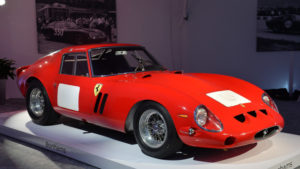 Image of a red Ferrari 250 GTO on a display platform.