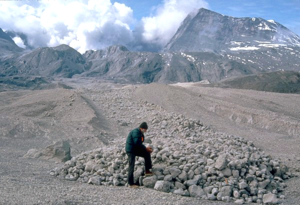 U.S. Geological Survey scientist examines pumice blocks at the edge of a pyroclastic flow from the May 18, 1980 eruption.