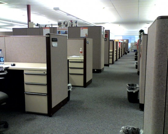 A long line of cubicles is shown.