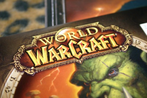 The cover of the video game World of Warcraft, including a green, fanged ogre, is shown here.