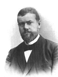 portrait of Max Weber in 1894. He's wearing a suit, has a trimmed, full-beard.