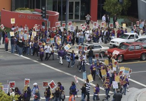 Janitors and supporters strike with signs in front of MTV network in Santa Monica.