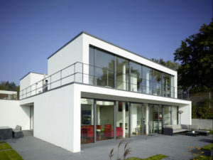 modern house exterior, with white walls and floor-to-ceiling windows