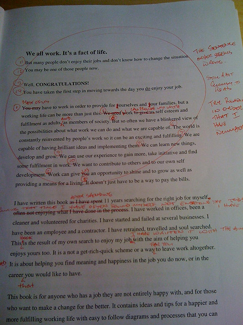 printed text with red edit marks all over the page