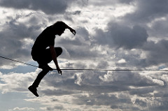 An unsteady person on a tightrope